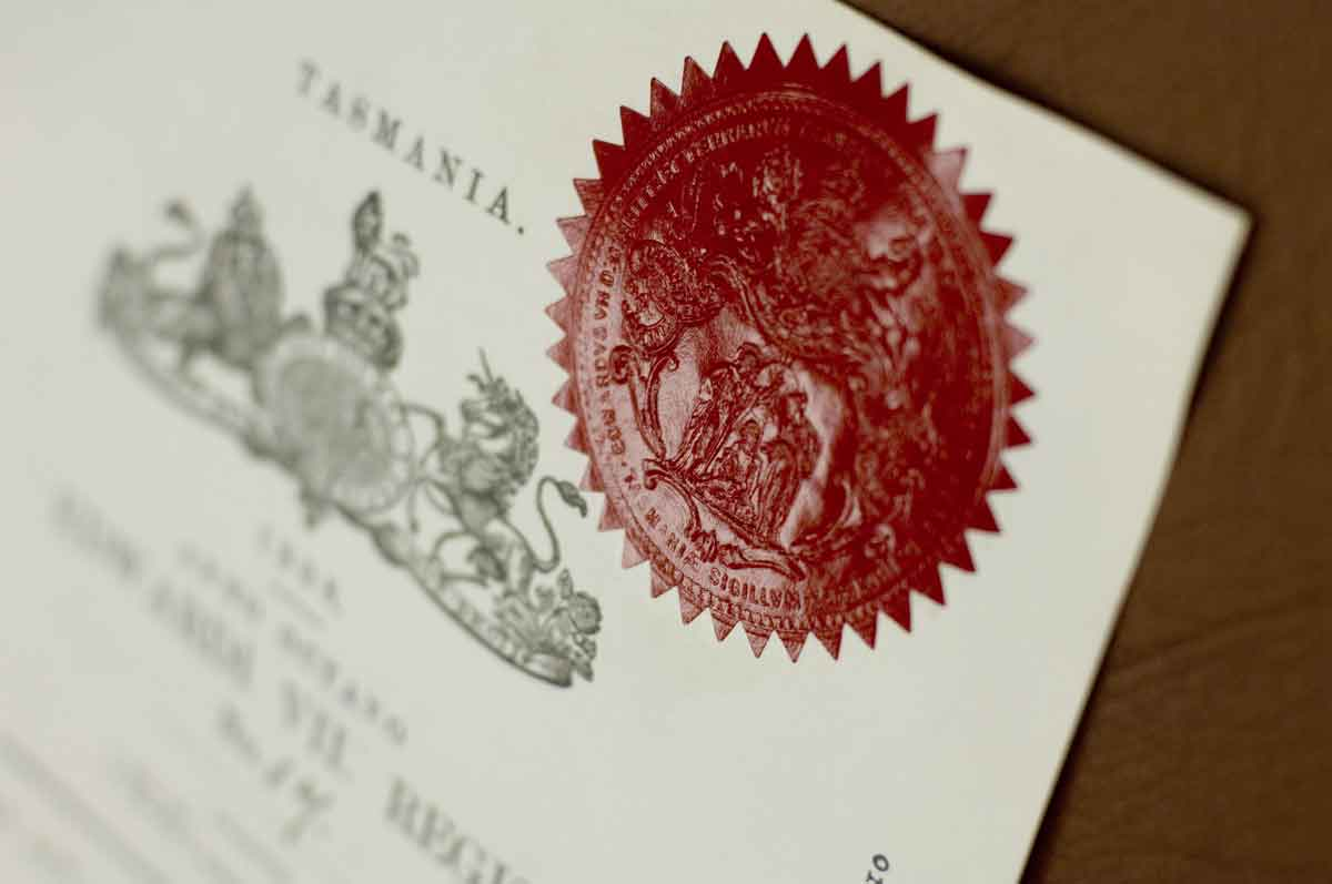 a government document with a seal stamp in focus